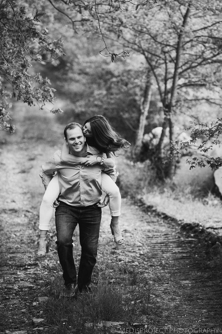 girlfriend gets a piggyback ride on her boyfriend