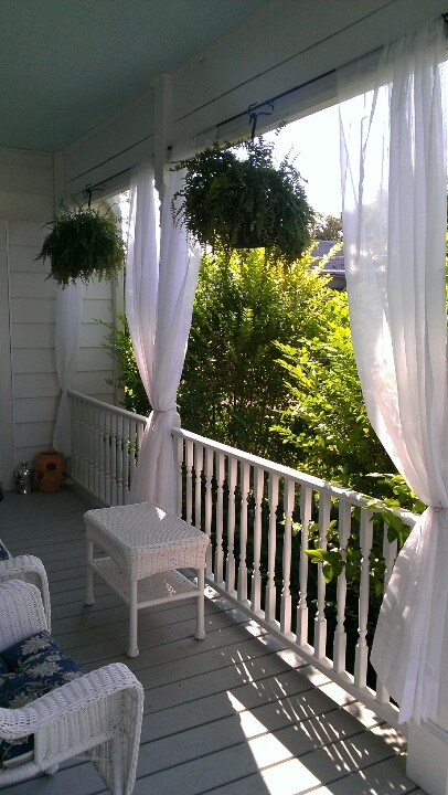 The curtains & plants >>> It gives off a  tropical feeling. What I want for our 2nd floor balcony next year.