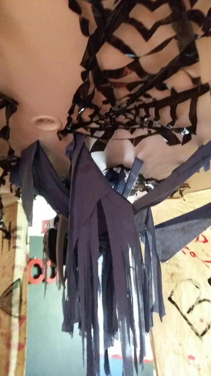 spider webs for halloween made out of  garbage bags