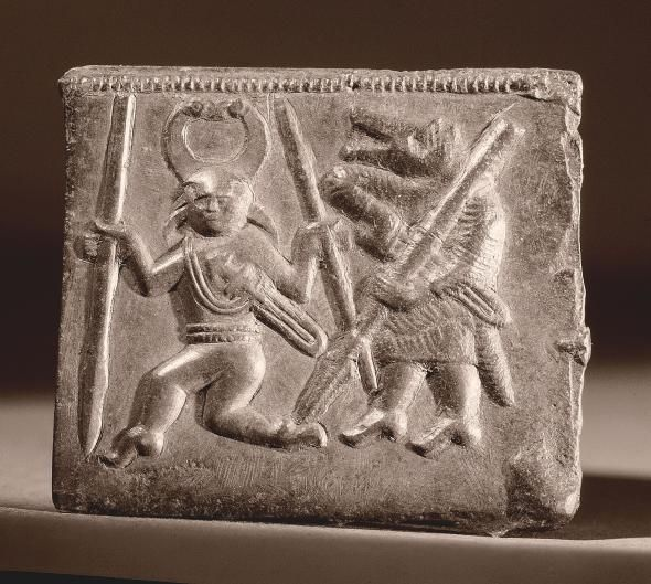 This sixth-century helmet plaque shows two berserkers, one wearing a horned helmet and one in a wolf or bear mask.  Photograph by Werner Forman, Universal Images Group, Getty Images