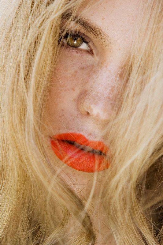 orange lipstick, maybe out of season, but similar skin/hair/eye color.