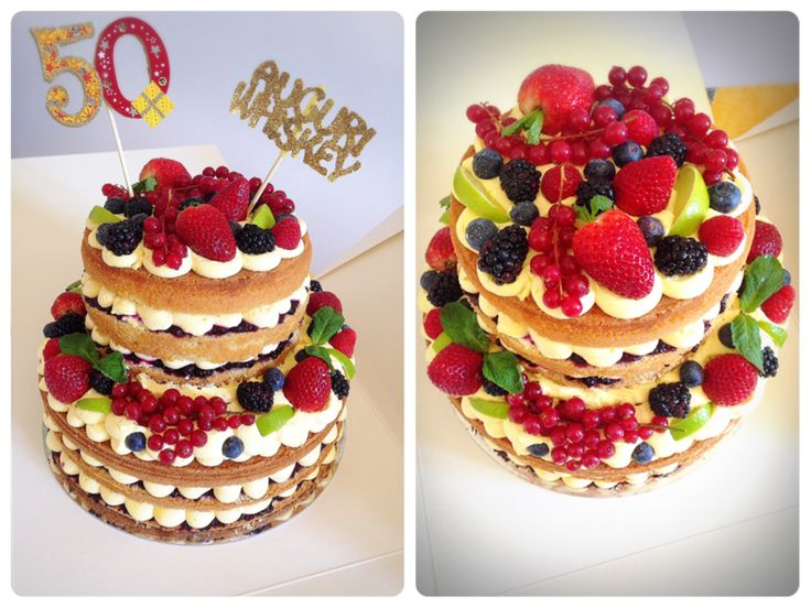 Naked Madeira cake filled with raspberries and blueberries jam, custard and fresh fruit
