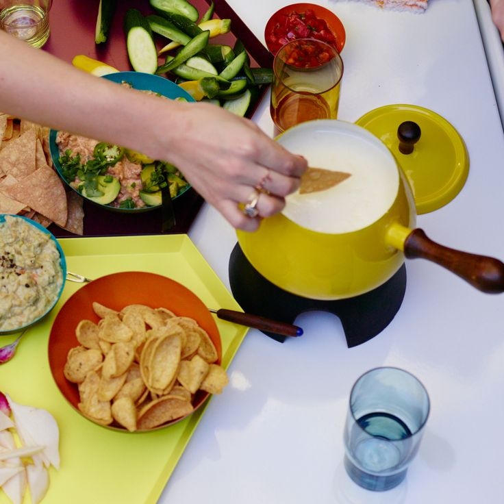 This best-ever warm cheese dip gets flavor from American, Manchego and sharp cheddar cheeses.