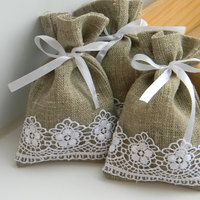 Burlap with lace favor bags filled with wild flower seed. A perfect gift that keeps giving.