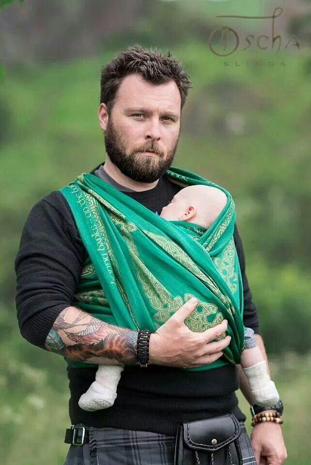 A Scottish guy in a kilt, with tattoos, wearing a baby. Mom porn.