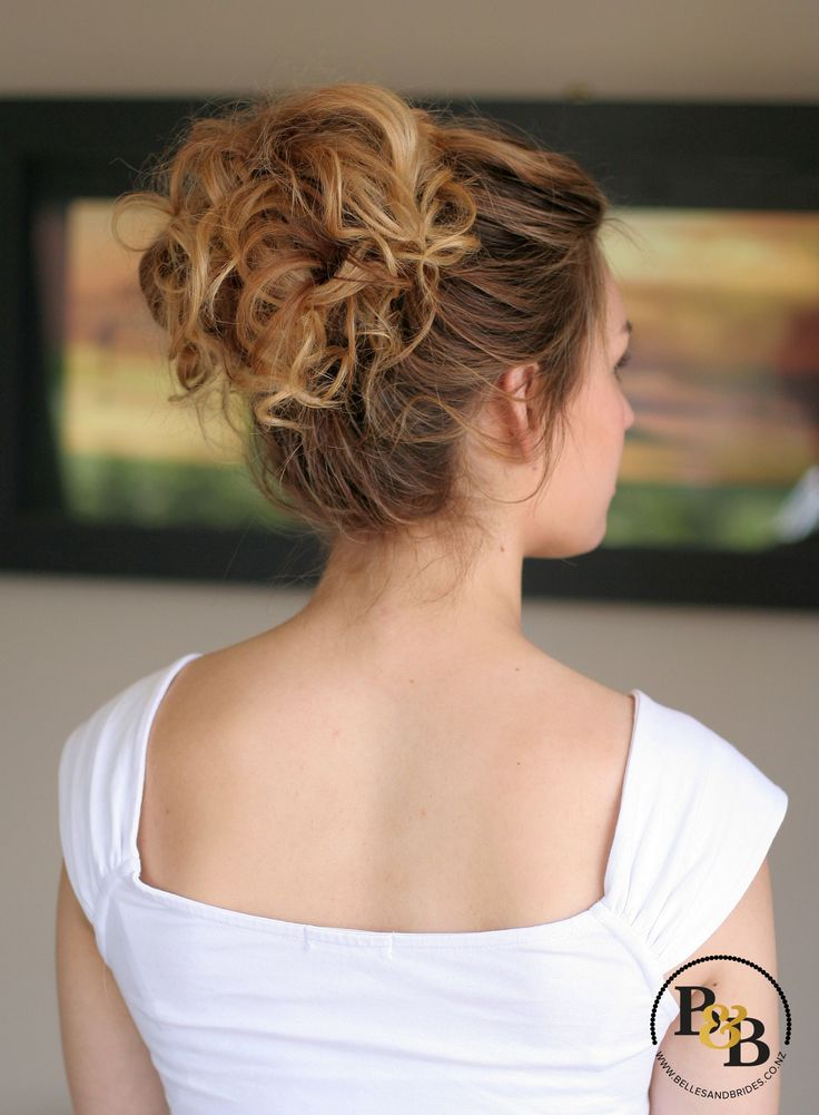 High loose wedding updo / messy casual bridal updo