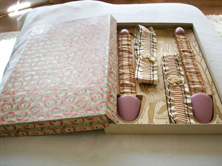 Antique garters and shoe stretchers of beautiful silk ribbon still in their original box. $124.00, via Etsy.