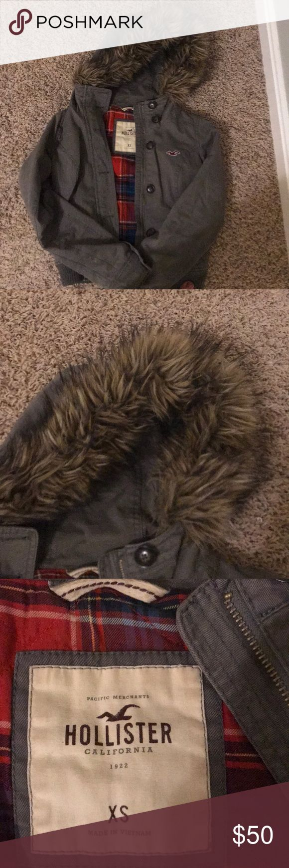 Hollister coat Hollister, fur lined hood coat (XS) really warm. With plaid lining. Color is a grayish green Hollister Jackets & Coats