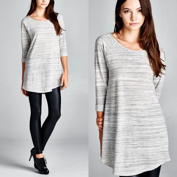 DORY loose fit tunic top - H. GREY Loose fit, three-quarter length sleeves, round neck raglan tunic top. Sleeves are cuffed and tacked. Rounded hems. This top is made with marbled french terry that is of medium weight, drapes well and is soft to the touch. Fabric 69% Cotton, 31% Polyester Made in U.S.A Tops