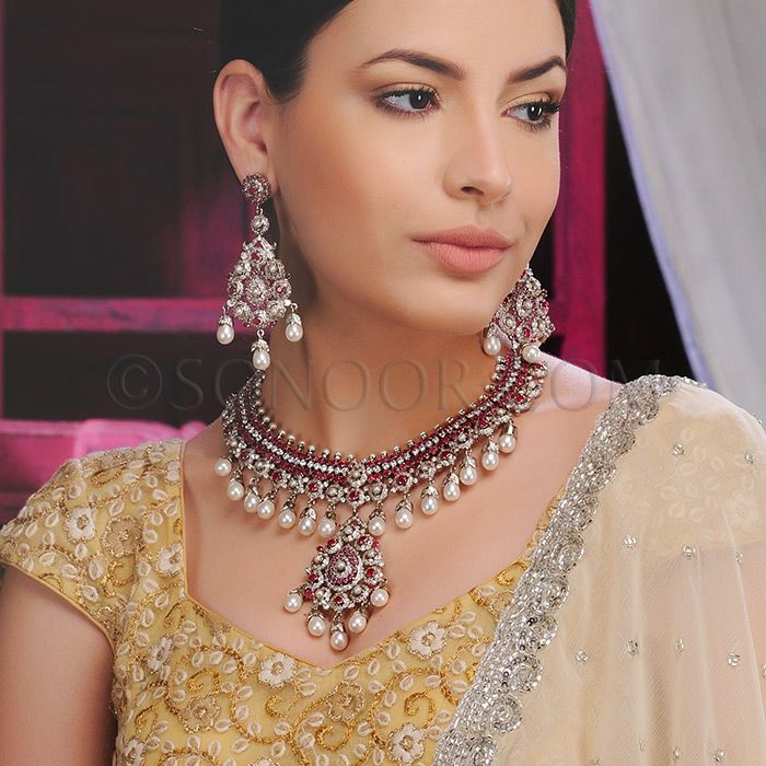 NEC/1/3420 Parin Necklace Set with Earrings in silver victorian finish studded with cubic zircons, ruby and pearls  $398