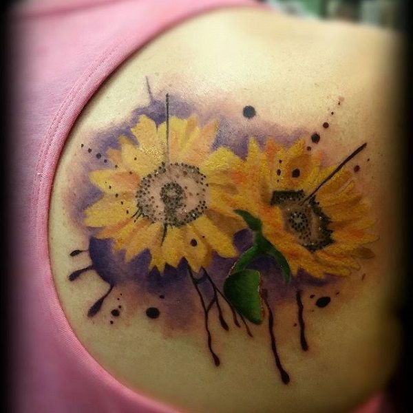 Sunflower by jason paradiso1 - A set of beautiful sunflowers tattooed on the back by Jason Paradiso. The sunflowers are shown to be sitting side by side surrounded by splashes of paint and a watercolor effect background.