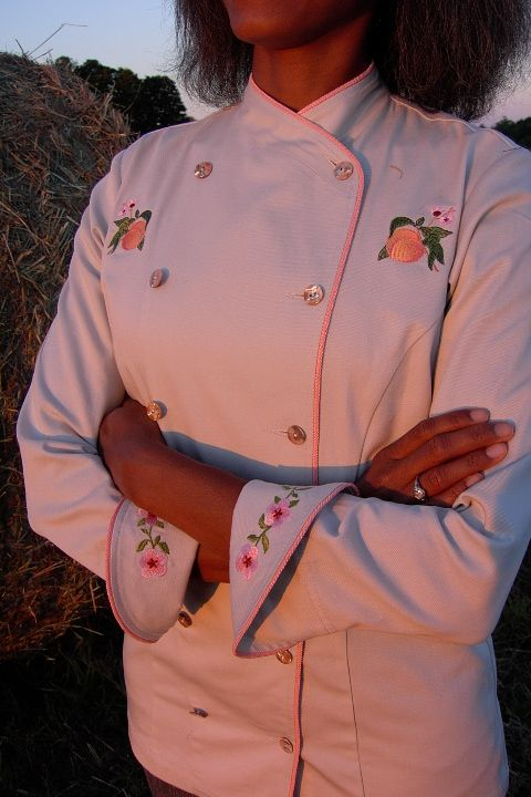 Women's Chef Coat Style BSW101: Shown in Ivory, 100% cotton Denim, bisque piping (collar, front & cuffs), Peach botanicals (one embroidered ...