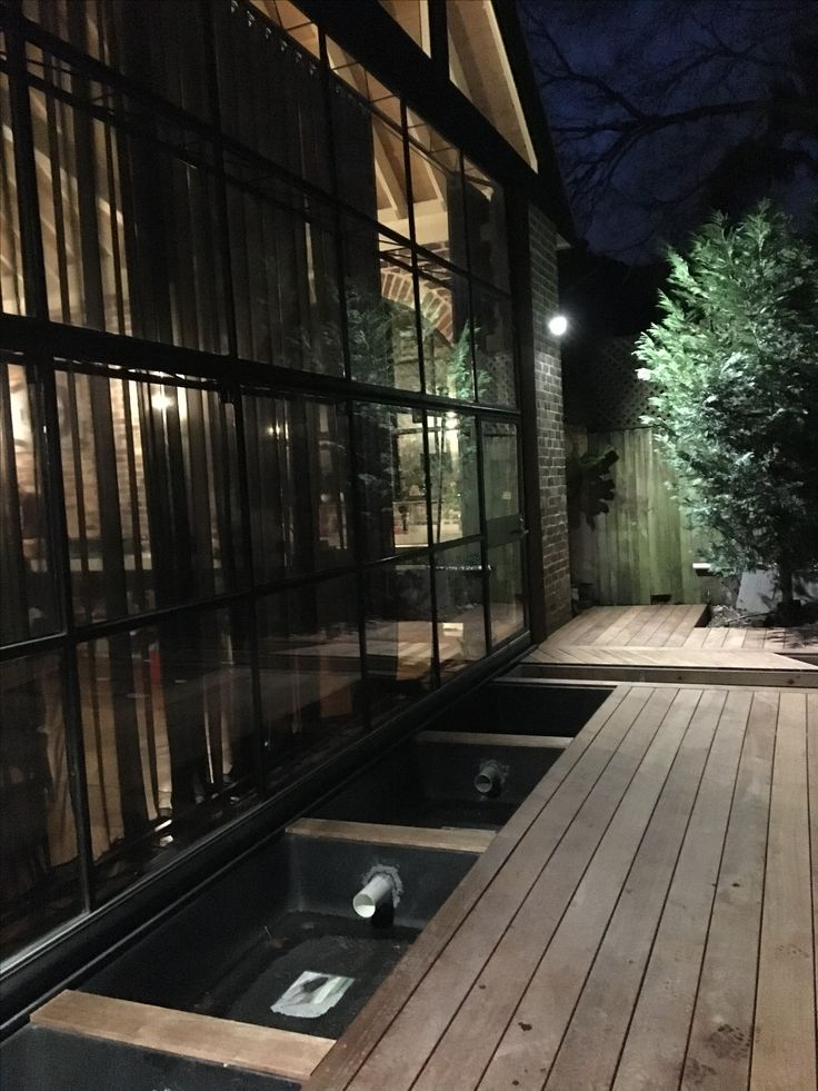 Outdoor decking at night with ponds