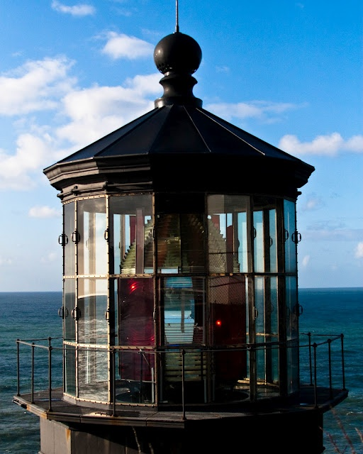 This light has a first order Fresnel lens made in Paris. The lens was shipped around Cape Horn, up the west coast to Cape Meares and then hauled 217 feet up the cliff by a wooden crane. It is an eight-sided lens with 4 primary lenses and 4 bull's-eye lenses with red panels covering the bull's-eye lenses. It produced about 30 seconds of fixed white light from the primary lens followed by a red flash of 5 seconds from the bull's-eye lens once every minute.  http://capemeareslighthouse.org/
