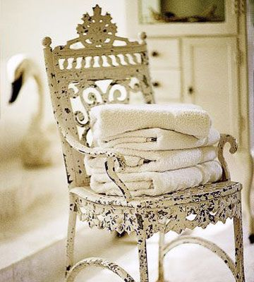 Cottage Accessories: Create the cottage look in your home by using pretty pastels and some of these traditional cottage accessories. That's Distressing:   Vintage furnishings often come with weathered and worn painted finishes. Preserve the look by thinking twice before repainting or refinishing. This old chair is full of interesting detail.: Vintage Chairs, White Chairs, Idea, Shabby Chic, Antiques Chairs, Gardens Chairs, Old Chairs, Towels, Wrought Irons