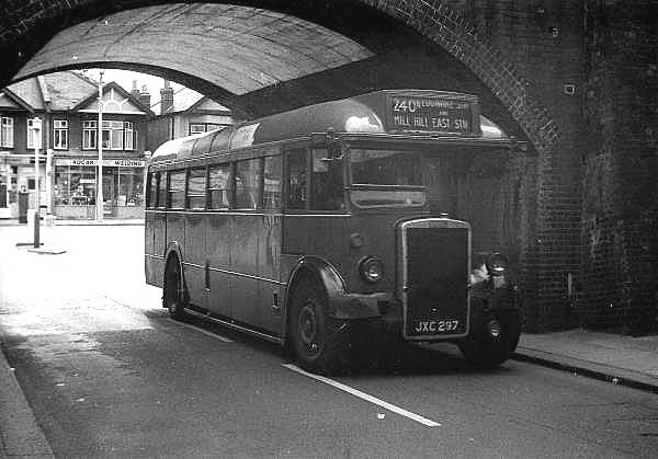 Old style 1960s single decker London Bus, under the railway bridge at Mill Hill Station on route towards Mill Hill East.