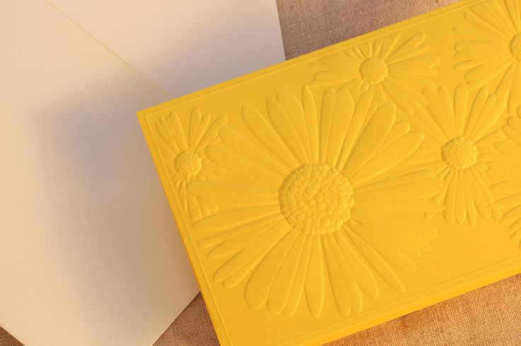 Saffron Jeweled Daisy Embossed Note: Embossed on heavy-weight lemondrop paper, this note is both tactile and bold. A smart choice for hellos from the Tahitian coast or thank yous after sunset cocktails on the lanai alike.