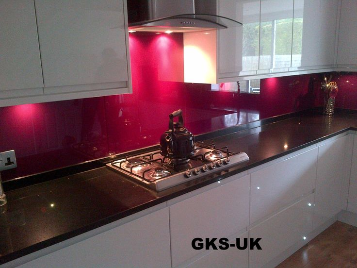 Pink splashback white kitchen black worktop