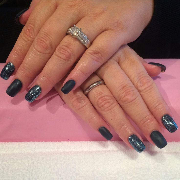 Matte black shellac with black glitter over acrylic nails done by Trine Fajardo at California Nails & Beauty Lounge #californianails #beautylounge #christmas #christmasnails #nails #negler #naglar #acrylicnails #shellac #nailart #jul #julenegler #cnd #opi #red #glitter #snowflakes #akryl #black #matte #mattenails