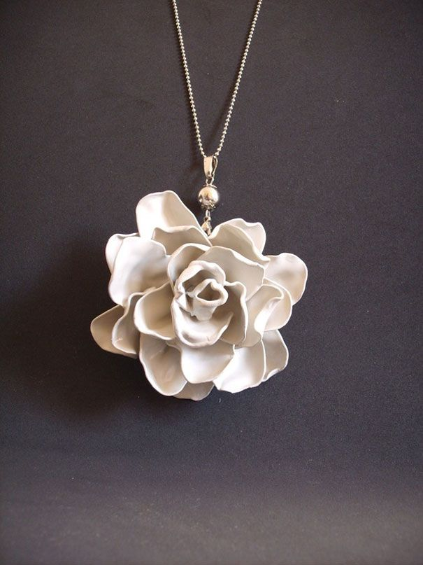 melted plastic spoons into rose necklace