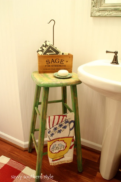 stool when you have no storage in a pedestal sink. add wood to the inside for shelves.