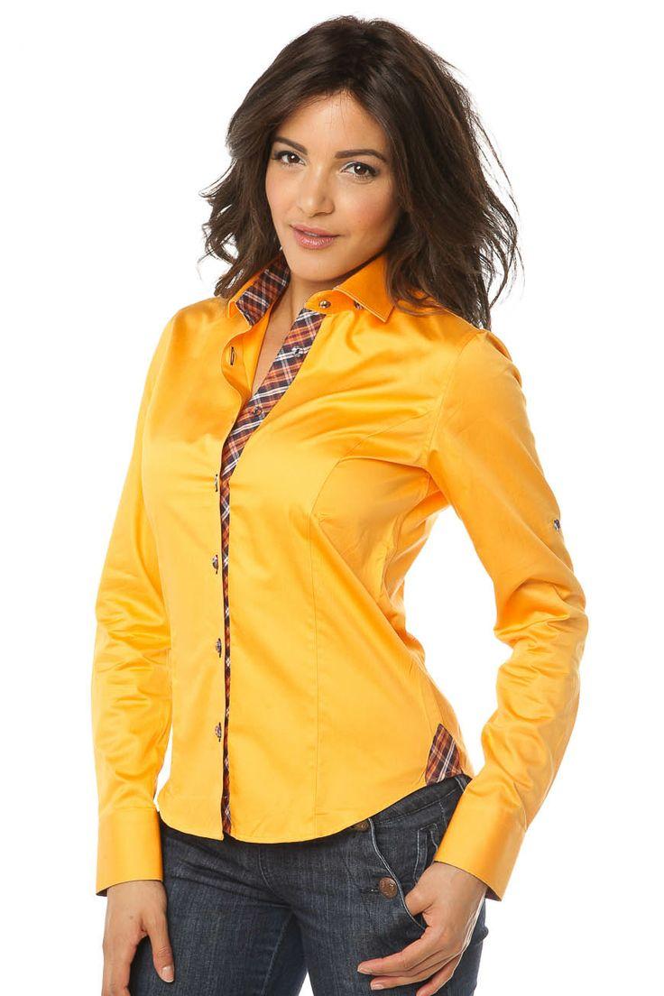 Chemise femme orange unie se distinguant par un intérieur col et poignet en  madras marron.