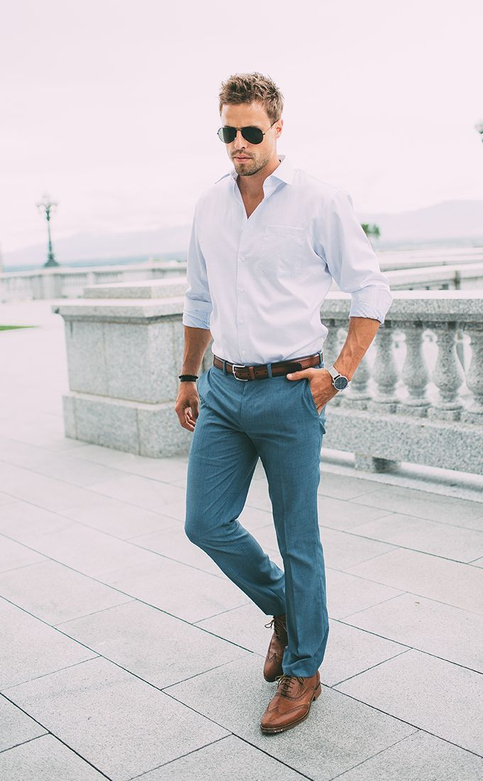 Shop this look on Lookastic:  https://lookastic.com/men/looks/long-sleeve-shirt-chinos-brogues-belt-sunglasses-watch-bracelet/12648  — Black Sunglasses  — White Long Sleeve Shirt  — Dark Brown Leather Belt  — Black Bracelet  — Silver Watch  — Teal Chinos  — Brown Leather Brogues