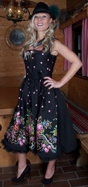 What an immensely beautiful pink and black floral pattern dirndl (want!!!). #dress #dirndl #German #folk #costume #traditional