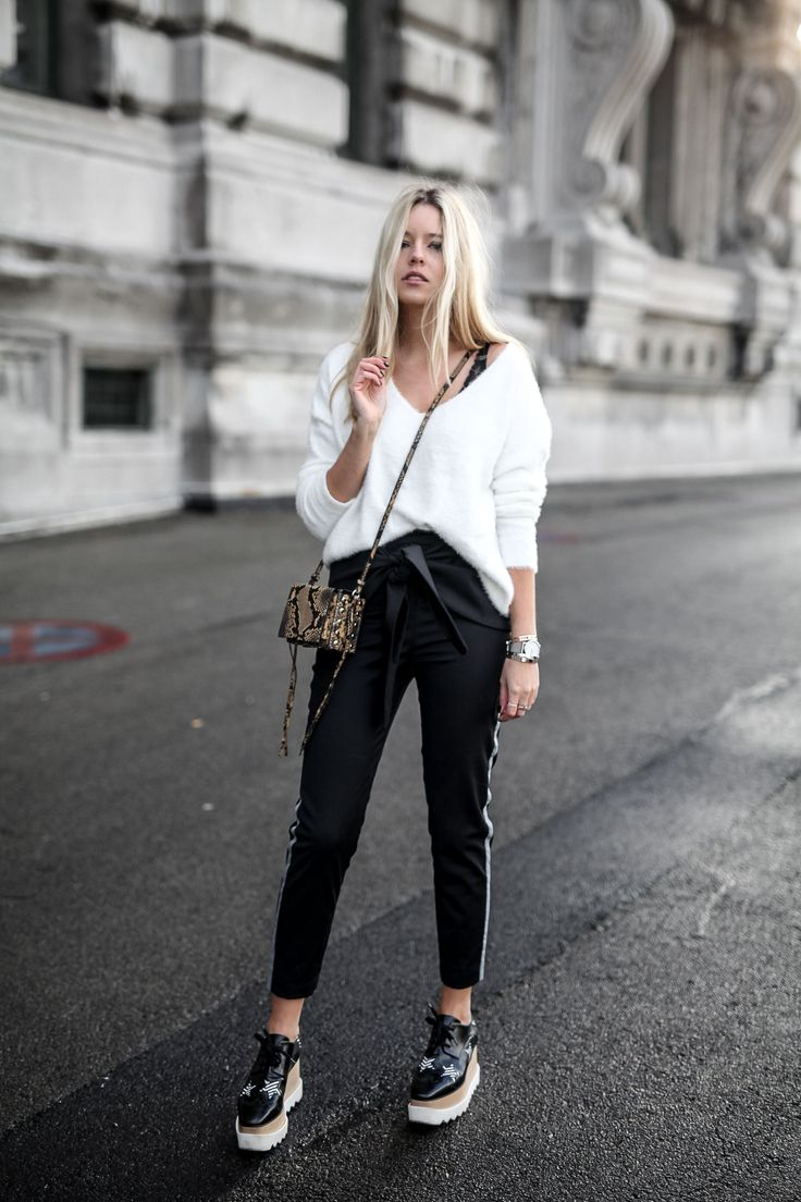 White knit, chino pants, and elyse stella mccartney shoes