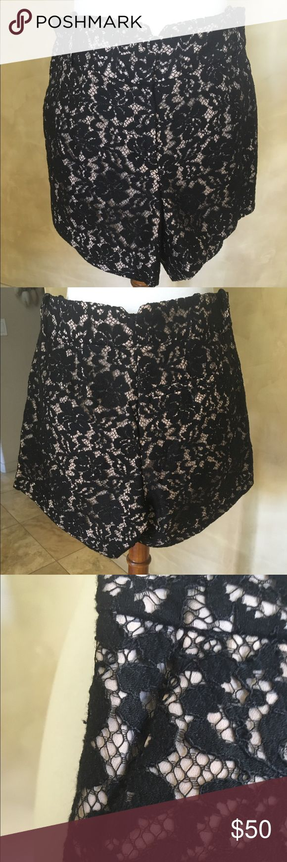 Black lace over nude shorts Beautiful black lace over nude shorts side pockets New no tags inseam 4.5 inches BCBGMaxAzria Shorts Bermudas