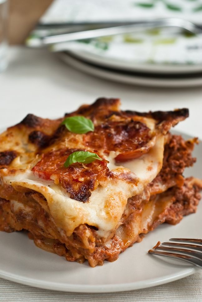 Lasagne originated in Italy, in the region of Emilia-Romagna. A traditional lasagne bolognesi is made by interleaving layers of pasta with layers of sauce, made with ragù, bechamel, and Parmigiano-Reggiano. #lasagne #food #madeinitaly
