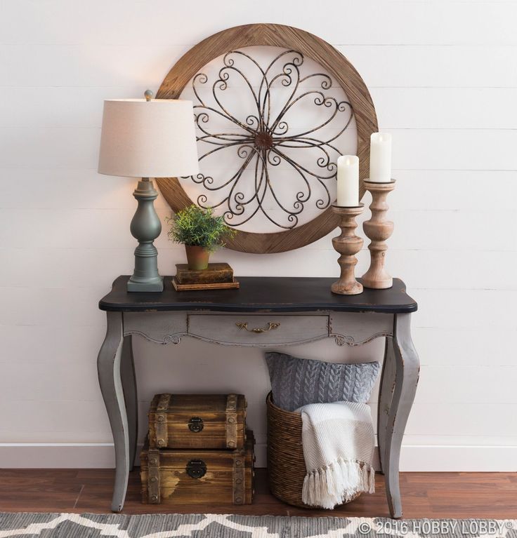 An elegant entryway doesn't have to be over-styled to be beautiful. Just choose a focal piece—like this lovely medallion—and style around it with cohesive pieces that provide color, texture and dimension.