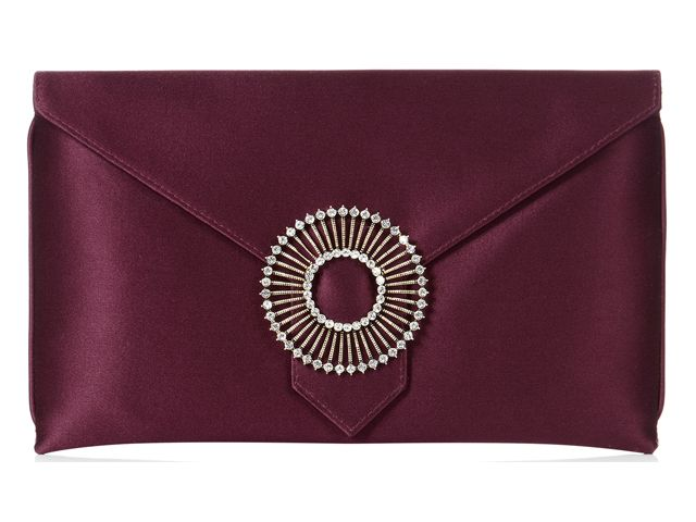 A stunning Edith Rosewood envelope clutch bag from Wilbur & Gussie. This bag has been beautifully designed with a burgundy 100% silk fabric and has a jewel encrusted brooch. Bag has an optional wrist strap, inner pocket and magnetic fastening. View more bags from our Wilbur & Gussie Collection at: http://www.baroqueboutique.co.uk/wedding-shoes-and-accessories/