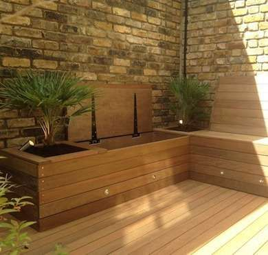 Lights built into seating. 1 Dozen Ways to Make the Most of a Small Yard - Use seating as storage and can even add planters.