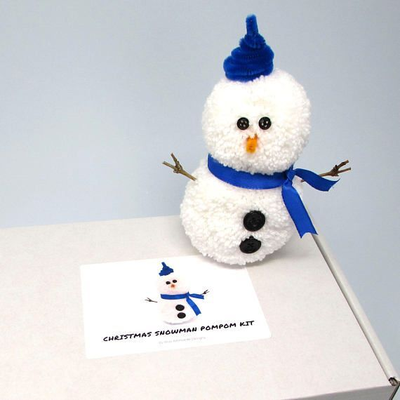 Keep the kids busy this Christmas holiday with this fun and super-easy craft kit to make your own pompom snowman. #christmas #christmascrafts #christmasactivities #activitiesforkids #holidayactivities #pompoms