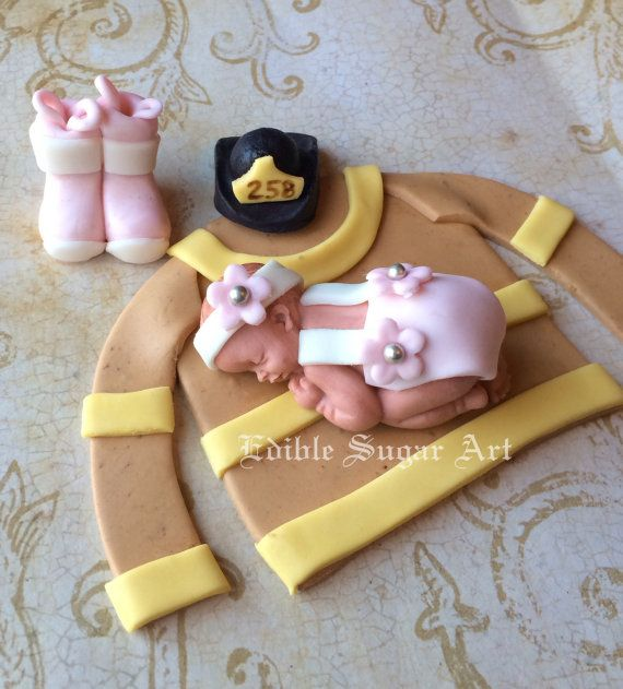 Fondant baby in pink girly fire gear  Boots, jacket and hat  Please leave customizations and date needed at checkout.  Thanks