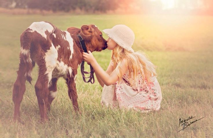 My daughter with a two days old calf. She loves animals so much, it's like she sees them in a special way, see their souls. © Ingvild Bolme Photography