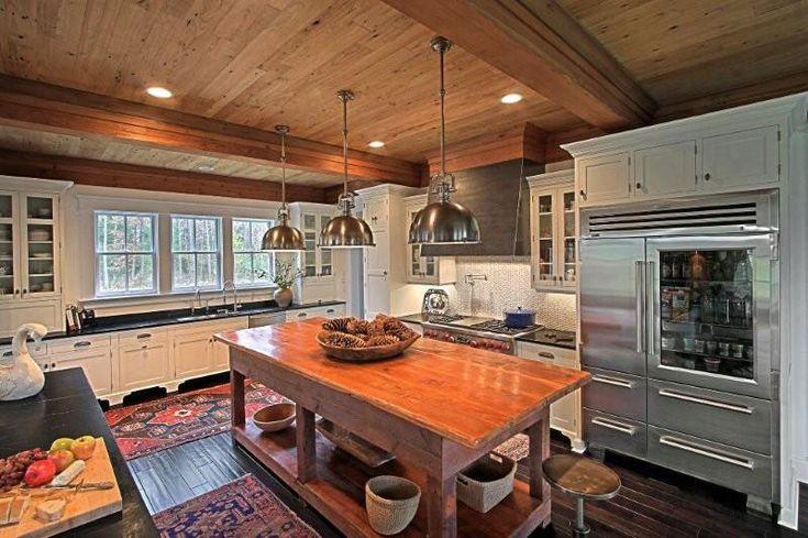 2008-2009 Sub-Zero & Wolf Kitchen Design Contest Regional Winner. Kitchen features reclaimed wood island, white woven ceramic tile backsplash and custom concrete faced hood.
