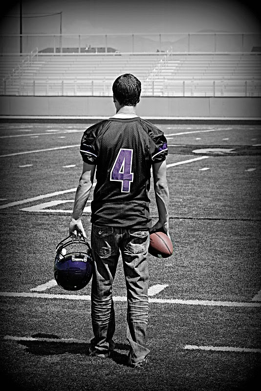 Football? Then YES, walking onto the field, helmet in one hand, ball in other. Color splash at least helmet and number. Black & White... Darken Corners.d