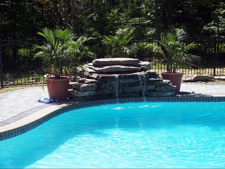 14 best pool waterfall ideas images on pinterest outdoor for Pool waterfall