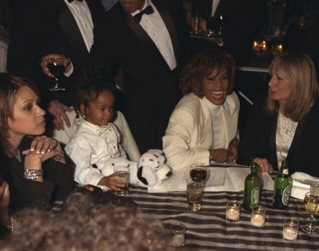 "Whitney Houston, her daughter, Bobbi Kristina Houston Brown, and director Penny Marshall at the premiere of the movie ""The Preacher's Wife"" in December 1996"