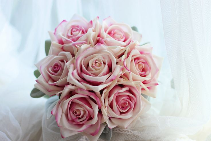 Erin's bridesmaid bouquet.  Karina pink ice real touch roses.