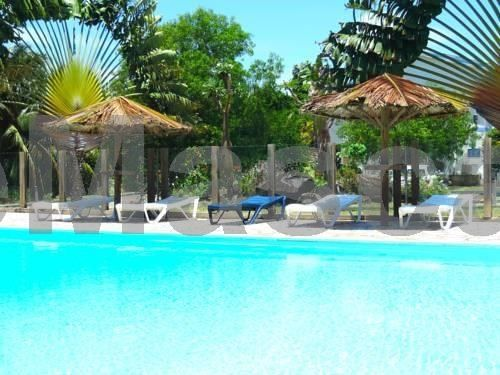 Les Cayalines Sainte-Luce Situated on the beachfront in Sainte Luce, Les Cayalines offers an outdoor pool, tropical gardens and bright self-catering accommodation with free Wi-Fi. Water sports facilities are available on site.