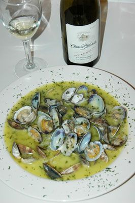 The worlds best steamer clams cooked in Chateau St Michelle Chardonnay,Tillamook butter, chives, garlic, and onion