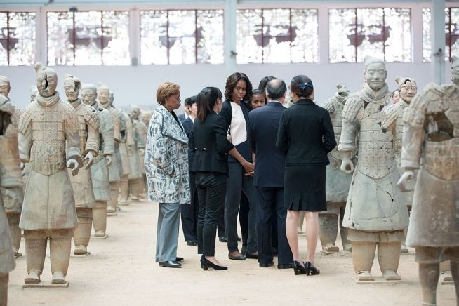 First Lady Michelle Obama, daughters Sasha and Malia, and Marian Robinson tour the Terra Cotta Warriors in Xi'an, Shaanxi Province, China, March 24, 2014. Cao Wei, Director of Terra Cotta Warriors, leads the tour. (Official White House Photo by Amanda Lucidon)