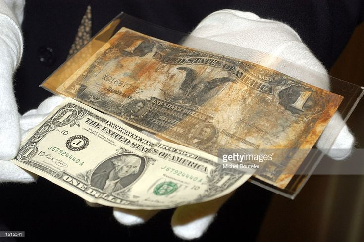 le titanic artifacts | bill is seen next to a current dollar bill at 'The Titanic Artifact ...