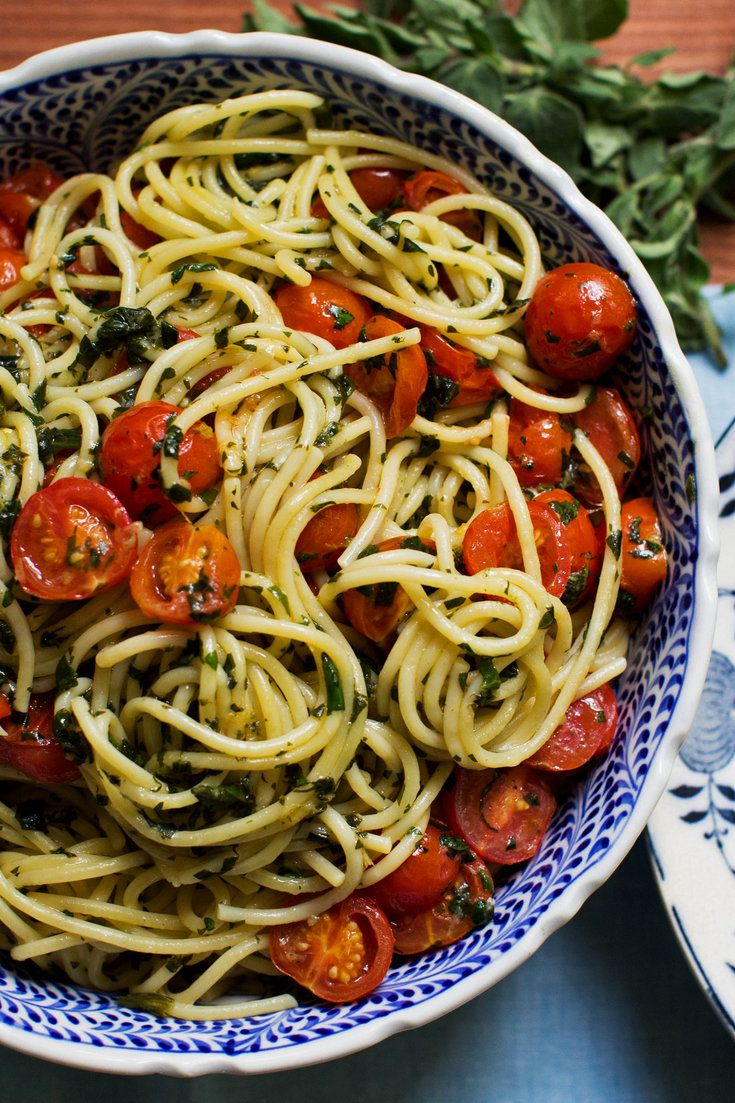 """In this simple recipe, raw pasta and cherry tomatoes are simmered together in a single pan, cooking the pasta and forming a thick, starchy sauce at the same time. The efficient technique is internet famous, but this is the British cookbook author Anna Jones's simple vegetarian take on the phenomenon, adapted from her book """"A Modern Way to Cook."""" The technique is easy to master and endlessly adaptable. (Photo: Meredith Heuer for NYT)"""