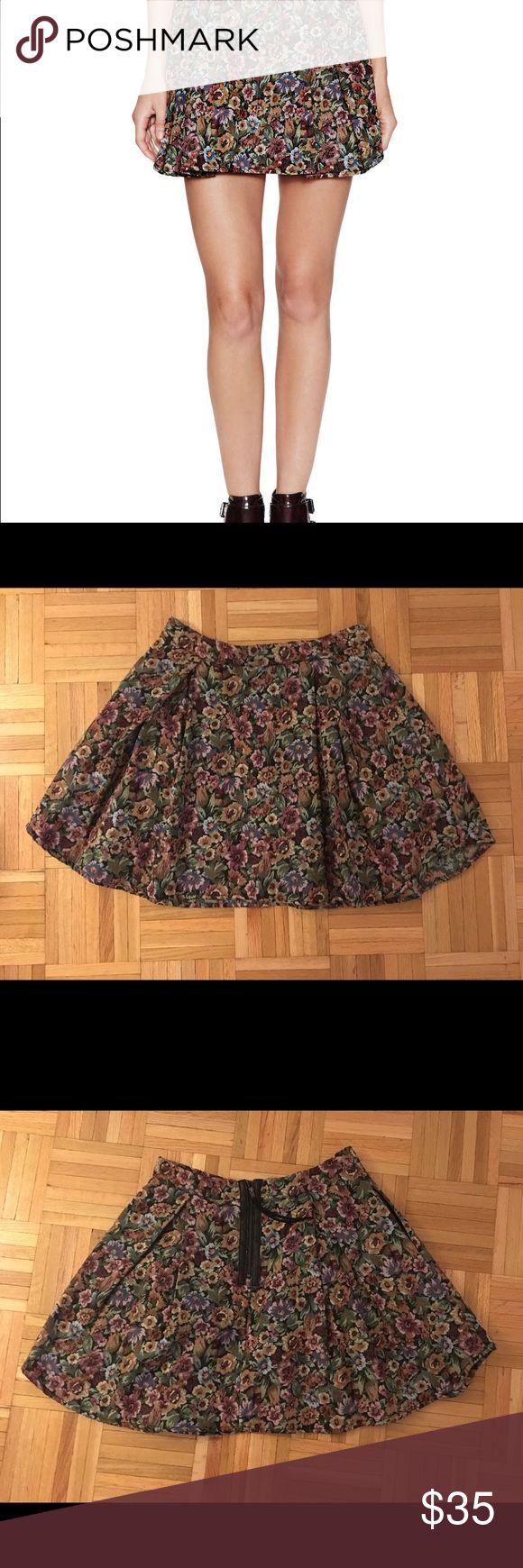 BCBGeneration Floral Mini Skirt Mini skirt with floral design on a black background in medium! BCBGeneration Skirts Mini