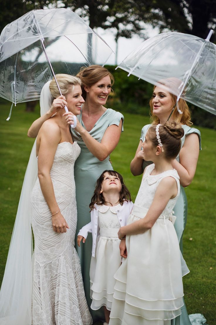 Bridal party from a spring rainy day tipi wedding in her parent's garden. Photography by http://www.mark-tattersall.co.uk/
