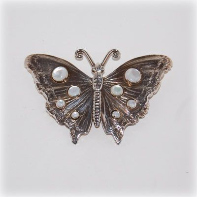 Handmade sterling silver butterfly brooch with mother of pearl cabochon. Made in our workshop.